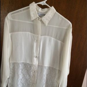 Off White to a very light cream button down blouse